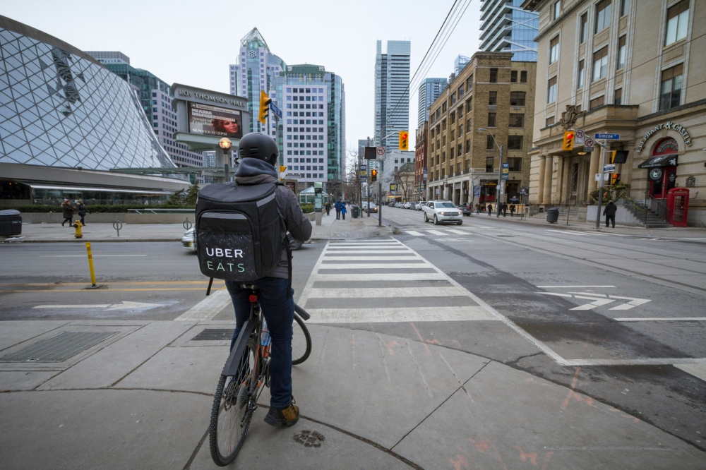 UberEats delivery man on a bicycle in Toronto